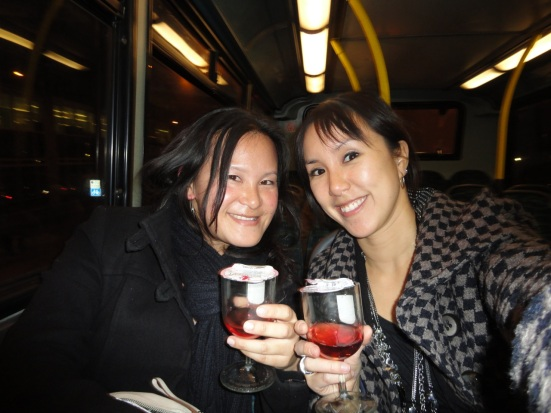 Girls drinking wine on a London bus