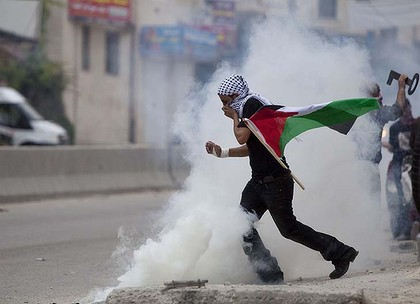 Middle East conflict tear gas protester